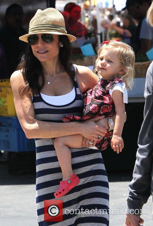 Bethenny Frankel holds her daughter Bryn as she...