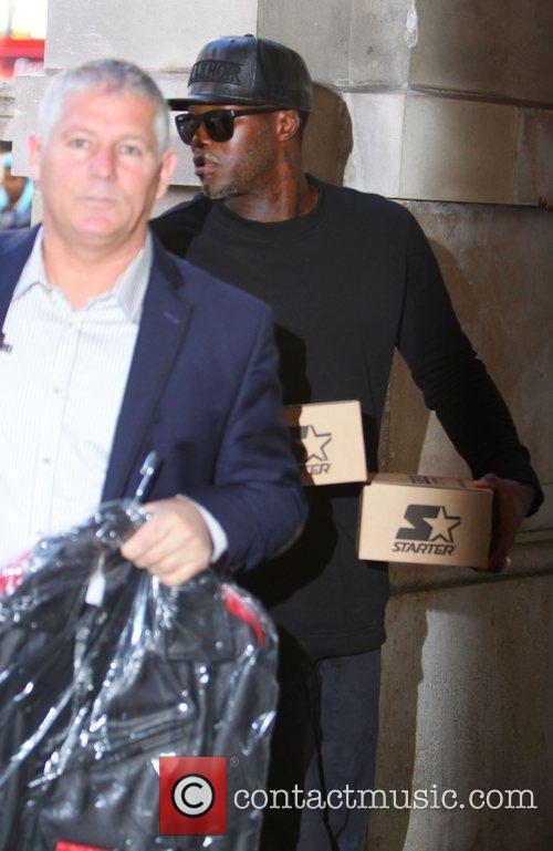 Djibril Cisse arrives at Justin Biebers hotel carrying...
