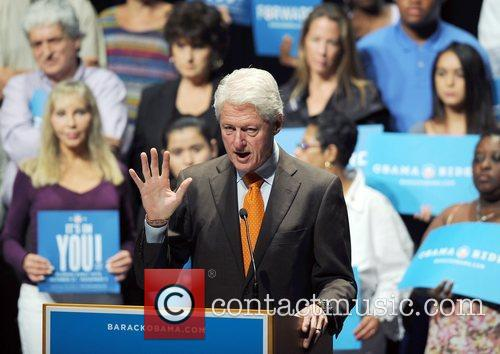 Bill Clinton addresses the audience at a rally...
