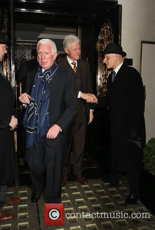 Bill Clinton leaves Scott's restaurant after having dinner...