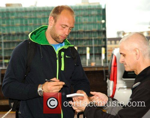 Robert Harting Athletes meet fans outside their hotel...