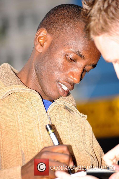 Sammy Mutahi Athletes meet fans outside their hotel...