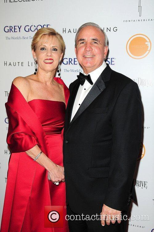 Mayor Carlos Gimenez (R) and wife Lourdes Gimenez...