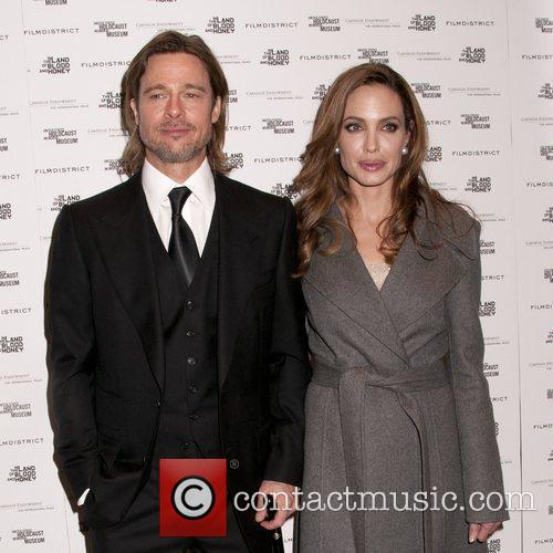 Brad Pitt and Angelina Jolie attending a special...