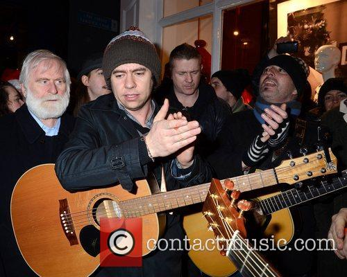 Bono and Glen Hansard join buskers singing for...