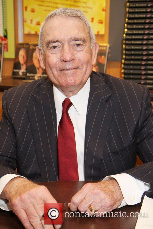 Former CBS News Anchor Dan Rather  autographs...