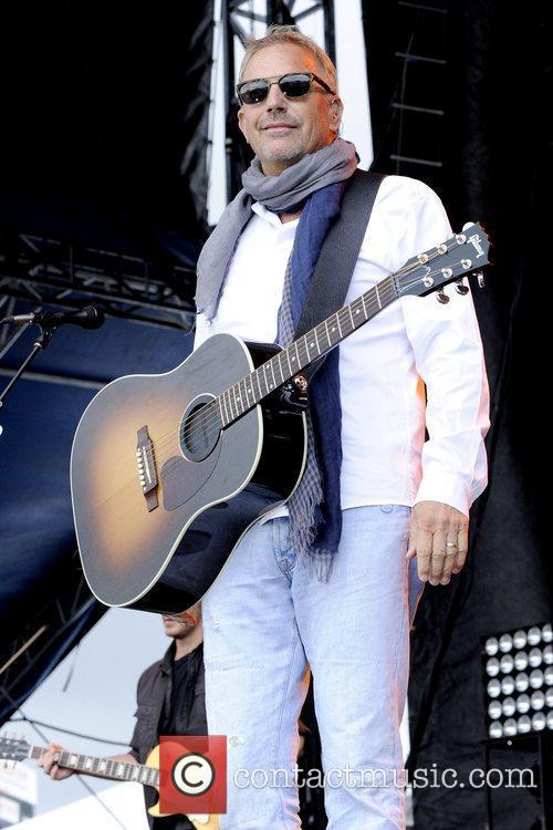 Kevin Costner   performs at the 1st...