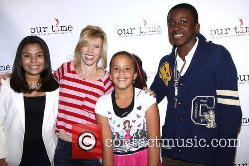 Maddie Corman poses with the 'Our Time' kids...