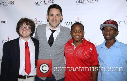 Steve Kazee poses with the 'Our Time' kids...