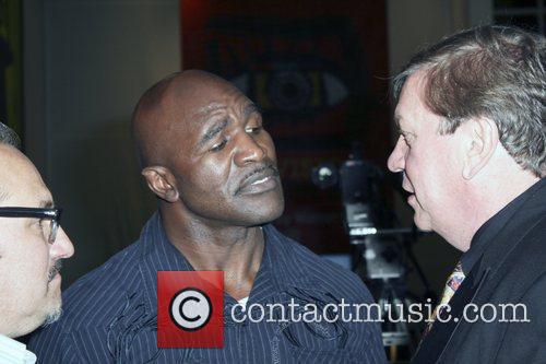 evander holyfield and beau szumilas attend the 5831358
