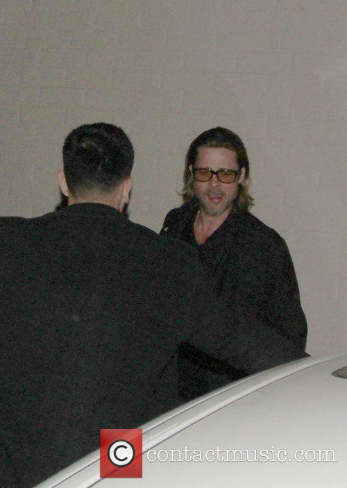 Brad Pitt returns to his car after dining...