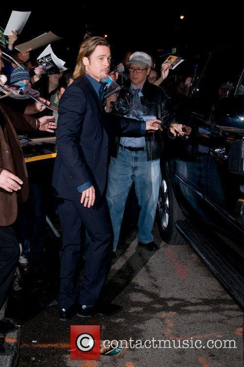 Brad Pitt  greeting his fans outside The...