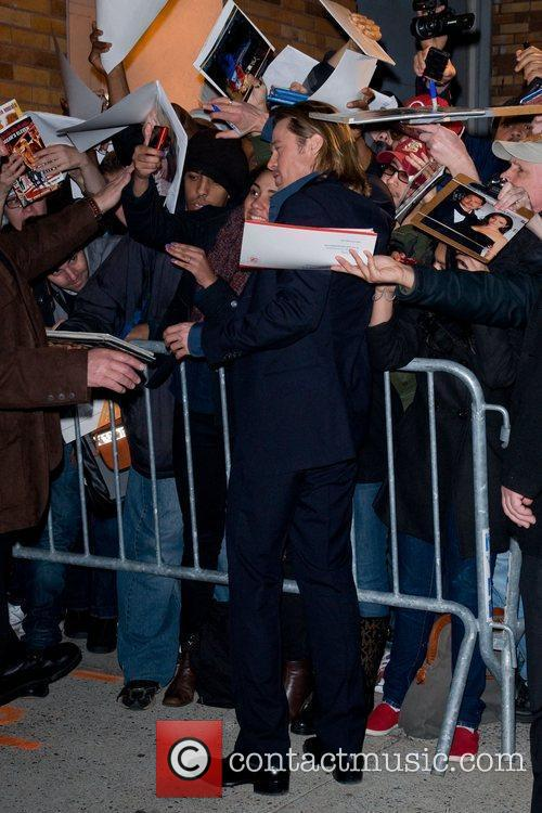Greeting his fans outside The Daily Show studios...
