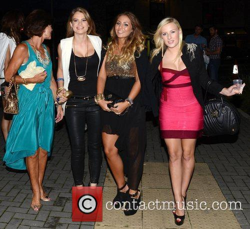 Brian McFadden and his fiancee Vogue Williams hold...