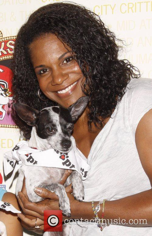 Audra McDonald holds Drago, a dog up for...