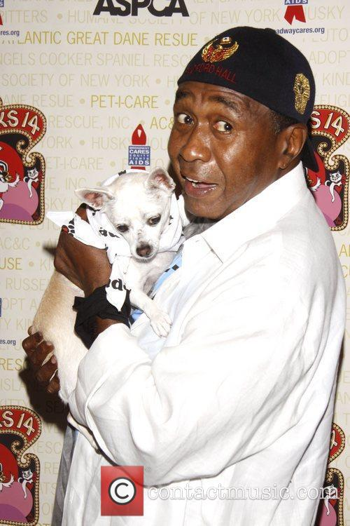 Ben Vereen holds Chachi, a dog up for...