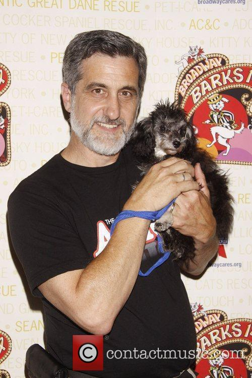 Bill Berloni holds Meghan, a dog up for...