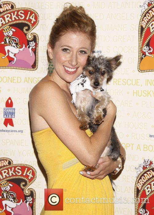 Caissie Levy holds Drago, a dog up for...