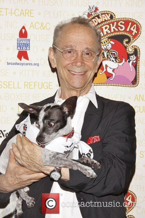 Joel Grey holds Drago, a dog up for...