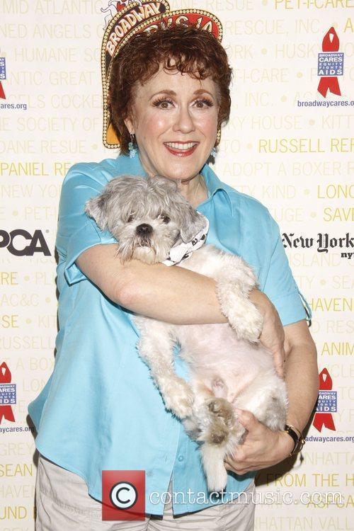 Judy Kaye holds Pepsi, a dog up for...