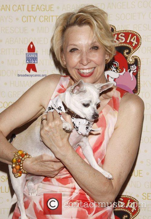Julie Halston holds Chachi, a dog up for...