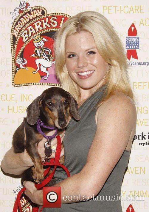 Megan Hilty holds April, a dog up for...