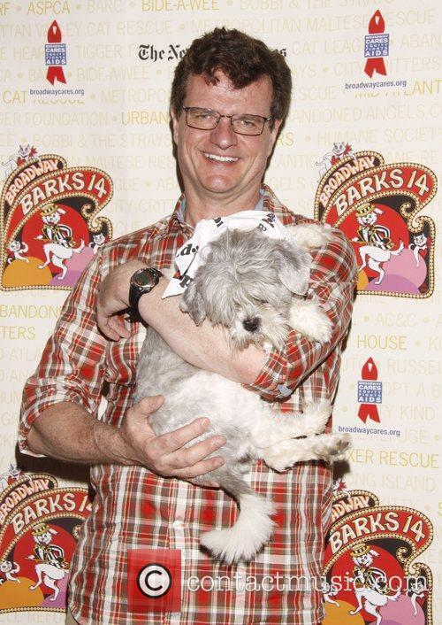 Michael Cumpsty holds Pepsi, a dog up for...