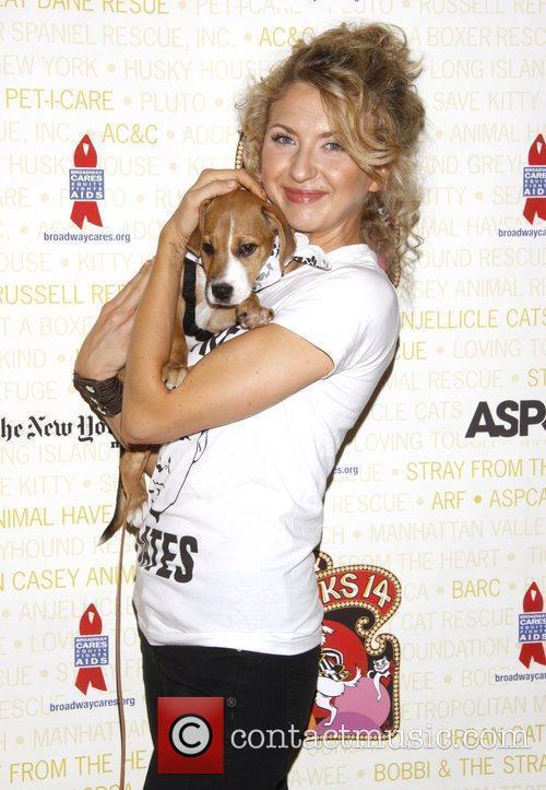 Nina Arianda holds Dolores, a dog up for...