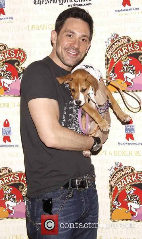 Steve Kazee holds Dolores, a dog up for...