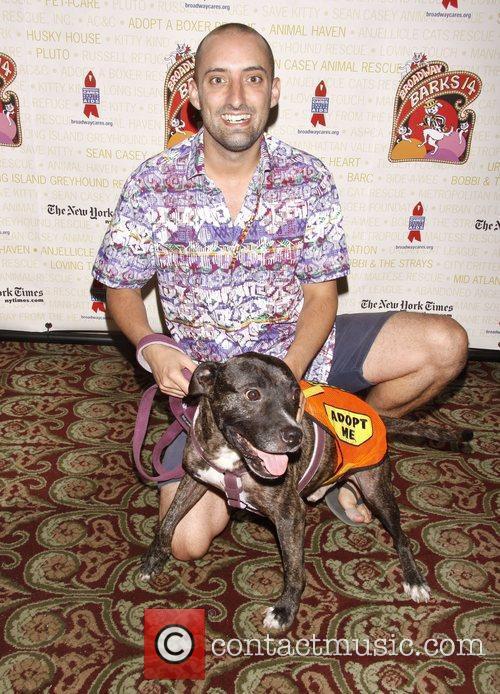 Tom Edden holds Drago, a dog up for...