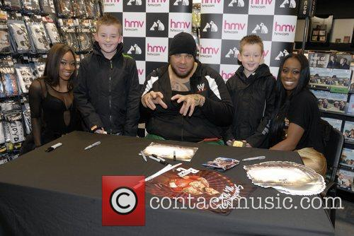 WWE Superstar Brodus Clay and the Funkettes, Naomi...
