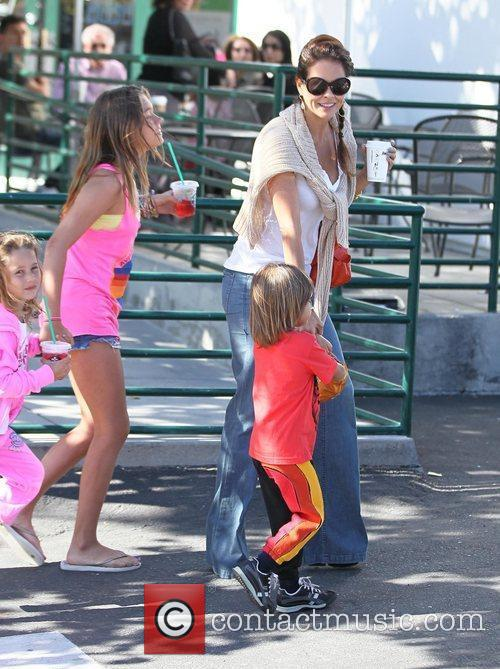 Leaving Starbucks in Malibu with her children, Heaven...
