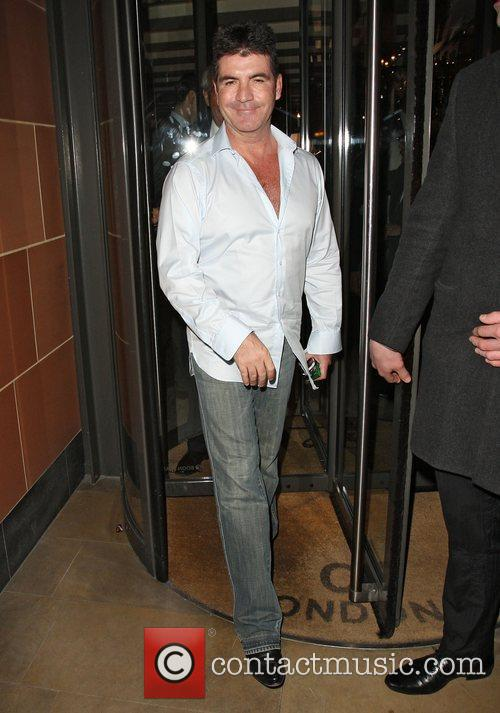 Simon Cowell leaving C London restaurant after dining...