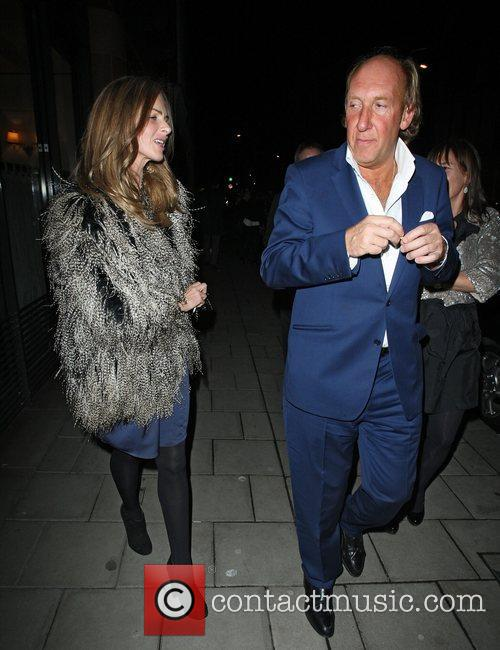 Trinny Woodall wearing a feather coat as she...