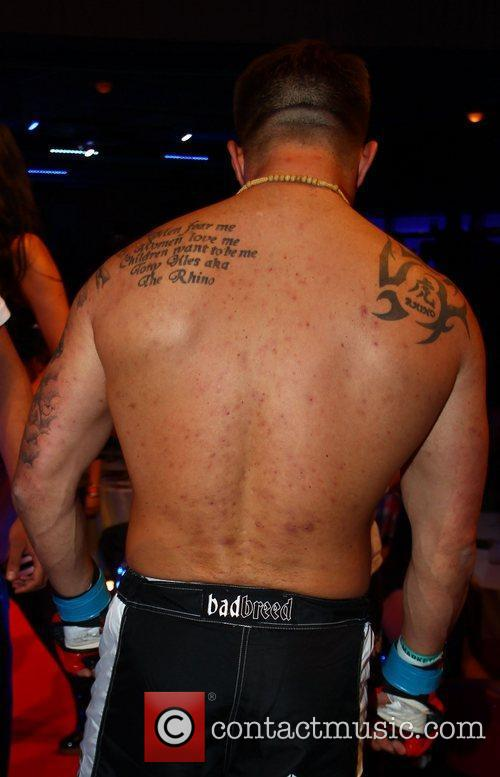 Tony Giles' back and tattoos  A cage...