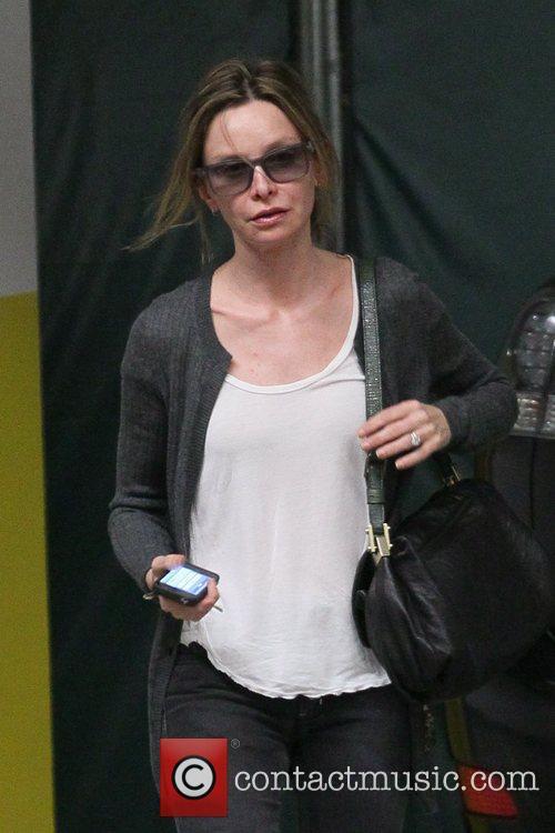 Calista Flockhart picking up her car after shopping...