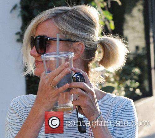 cameron diaz hides behind her drink while 4027137