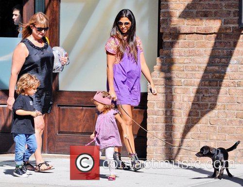 A pregnant Camila Alves  and her children...