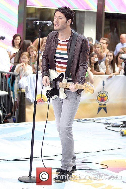 Adam Young of Owl City performing live during...