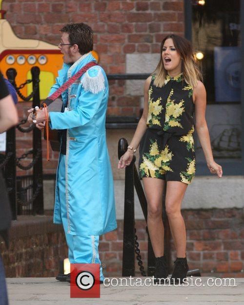 Caroline Flack filming with a Beatles tribute band...