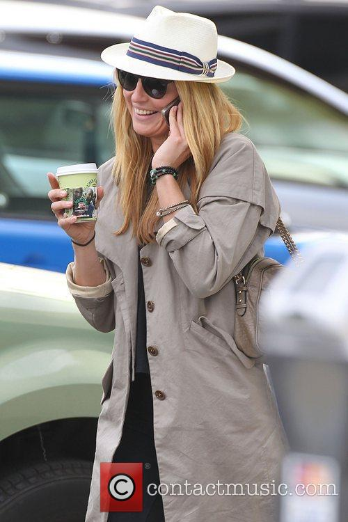 Cat Deeley talks on her mobile phone after...