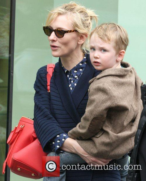 Cate Blanchett walking up Madison Avenue carrying her...