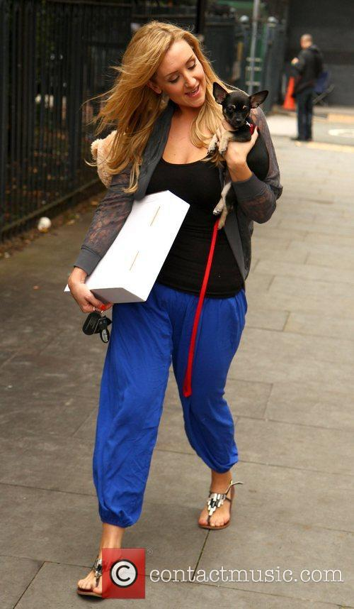 Leaving the Granada studios with her little dog