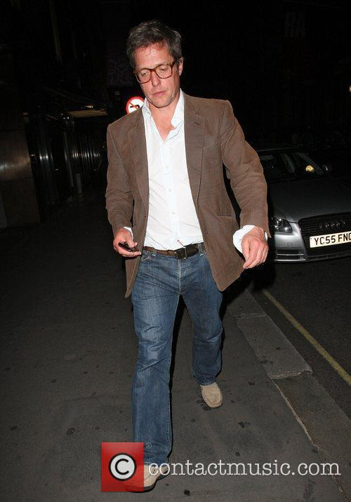 Hugh Grant leaving Cecconi`s restaurant in brown jacket...