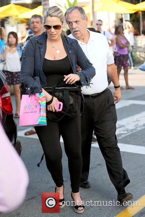 Elizabeth Berkley keeps her stomach covered at The...