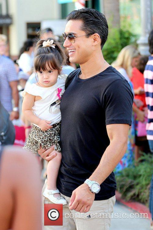 Mario Lopez holding daughter Gia Francesca Lopez Celebrities...