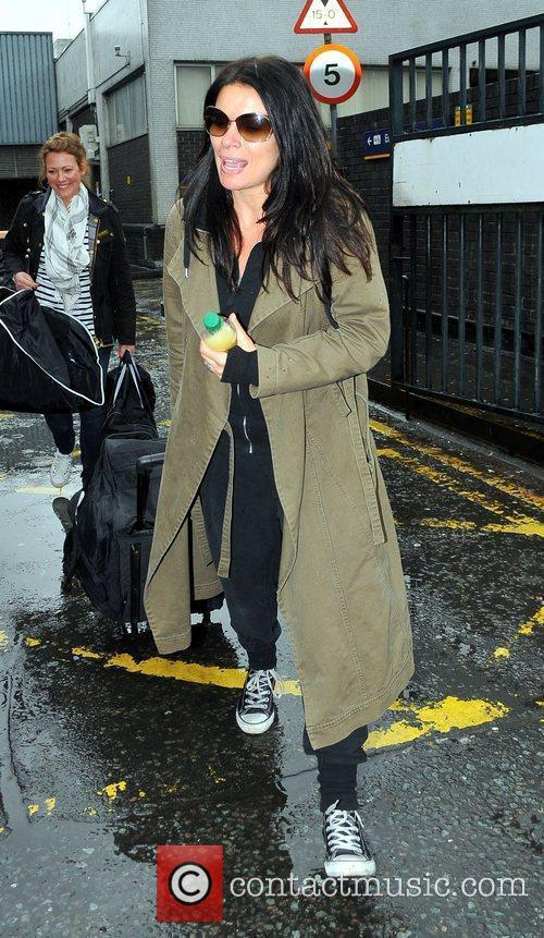 Alison King arrives at Euston Station to attend...
