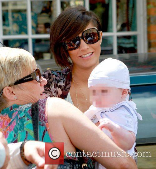 Frankie Sandford holding a baby  Celebrities leaving...
