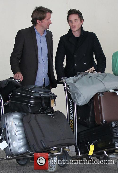 Tom Hooper and Eddie Redmayne arrive at LAX...