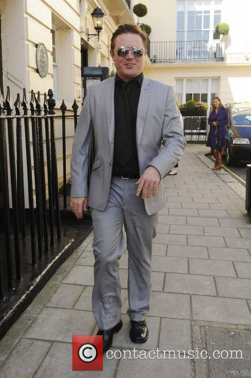 Alex Ferns leaves a theatre to head for...